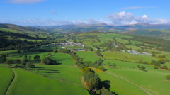 High aerial drone footage of a Welsh village set in stunning countryside Stock Footage