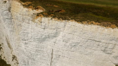 Close-up aerial drone footage of Seven Sisters cliff edge Stock Footage