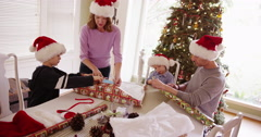Lovely caucasian family preparing holiday gifts together Stock Footage