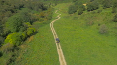 Car driving up a track on the Yorkshire Moors, UK Stock Footage
