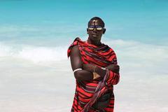 Maasai on the beach - stock photo