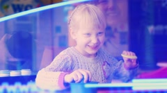 Blonde woman enthusiastically playing air hockey, laughing, having fun Stock Footage