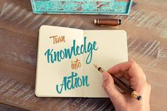 Written text TURN KNOWLEDGE INTO ACTION - stock photo