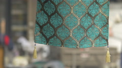 A fabric with tassels hanging on a street stall in Sarajevo - stock footage