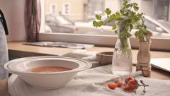 On the table tomato soup pours in bowl at dinner. Macro Stock Footage