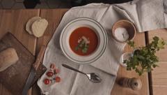 Top View Chef Serving tomato soup with cilantro and bacon in restaurant Stock Footage
