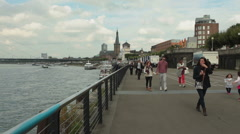 Rhine river promenade, large crowd of people walking Stock Footage