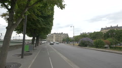 Stock Video Footage of Cars riding and people walking on Cours Albert 1er street  in  Paris
