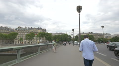 Stock Video Footage of People walking and cars driving on Pont de l'Alma in Paris