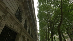 Street with old buildings and trees in Paris Stock Footage