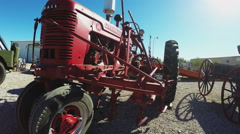 Slow Zoom On Antique Farm Tractor In Desert Stock Footage