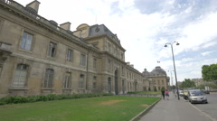 Couple walking in front of the Military School in Paris Stock Footage