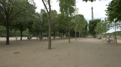 People spending spare time in a park near Place joffre and Eiffel Tower in Paris - stock footage