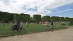 People spending their spare time in a park in Paris - stock footage