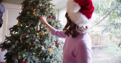 Happy caucasian family spending x-mas in front of the christmas tree - stock footage