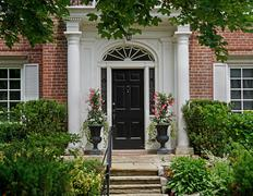 front door with portico entrance and flagstone steps - stock photo