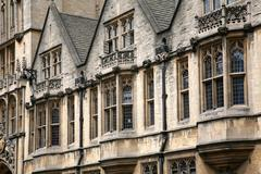 Stock Photo of Oxford gothic college building, bay windows overlooking street