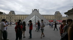 Many tourists walking in the Napoleon Courtyard, Paris Stock Footage