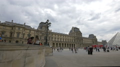 Tourists walking and taking pictures in the Napoleon Courtyard, Paris Stock Footage