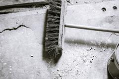 Black and white shot of an old broom Stock Photos