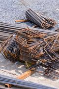 Rusty rebar for concrete reinforcement at construction site. - stock photo