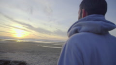 Close up of man watching the sunset Stock Footage