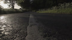 Traveling Down An English Countryside Road At Sunset Stock Footage