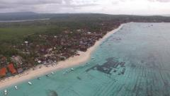 AERIAL UPWARD TILT SHOT OF A BEACH AT NUSA LEMBONGAN BALI Stock Footage