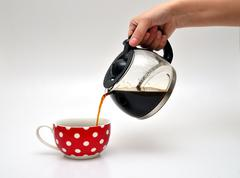 Pouring coffee in a cup Stock Photos