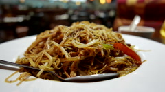 One side of fried noodle with smoke inside Chinese restaurant. Stock Footage