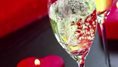 pouring champagne flutes near red candles burning, love and valentine day - stock footage