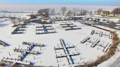 Frozen harbor, marina in winter, Wisconsin, Aerial Flyover Stock Footage