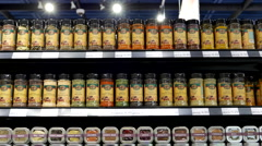 Motion of display seasoning on shelves in organic supermarket Stock Footage