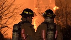 Firefighters Silhouetted in Fire Stock Footage