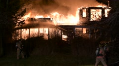 House Fire With Heavy Flames & Multiple Firefighters Stock Footage