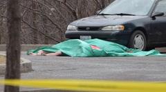Dead Body in Parking Lot Stock Footage