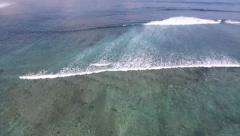 AERIAL high angle shots of ocean waves breaking towards beach Stock Footage