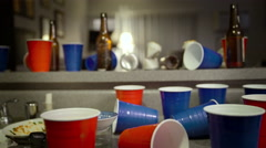 Dirty Dishes and Beer Bottles After Party - Dolly Left - stock footage