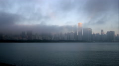 Time lapse of low clouds blowing over Chicago from across the water. Stock Footage