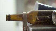 Bra Hanging on Beer Bottle - Tilt Down Stock Footage