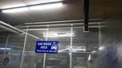 People washing car at underground car wash area Arkistovideo