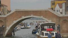 Boats passing under a bridge in Canale di Cannaregio, Venice Stock Footage