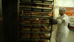 Industrial oven for baking bread. - stock footage