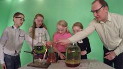 Stock Video Footage of Students in primary school and the teacher does a science experiment.