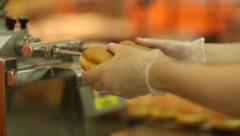 Bakehouse. Cooking buns with cream. - stock footage