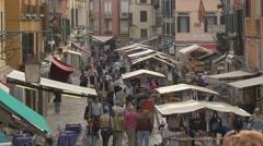 Tourists walking on Rio Tera S. Leonardo in Venice Stock Footage