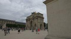 Walking next to the gate of the Jardin des Tuileries, Paris Stock Footage
