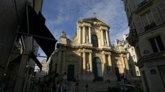 People walking on Rue Saint-Honore near Saint Roch church in Paris Stock Footage