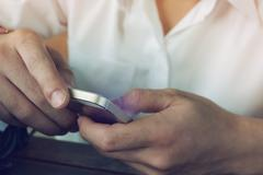 Businessman using a mobile phone with texting message on app smartphone, play Stock Photos