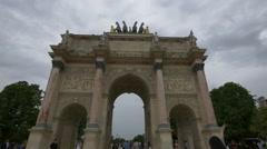 People walking through Arch de triomphe in Paris Stock Footage